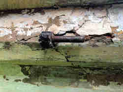 Metalwork is treated to mitigate further rust attack.